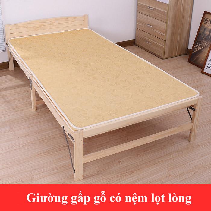 Giường gấp gỗvới nệm bọt tùy chỉnh.